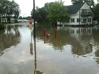 Dash view of flooding streets in Arcadia, early July 20 morning. Photo: Derek Olson, Osseo Fire Department