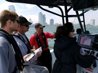 Wardens help teach water rescue training on Lake Michigan.