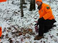 'Warden Dahlquist uses a 1-gallon pitcher to measure bait and explain the bait law to a hunter.