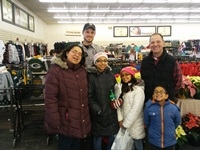 Warden Bryan Harrenstein of the Antigo Warden Team and his shopping crew are all smiles on their  Shop with a Cop outing.