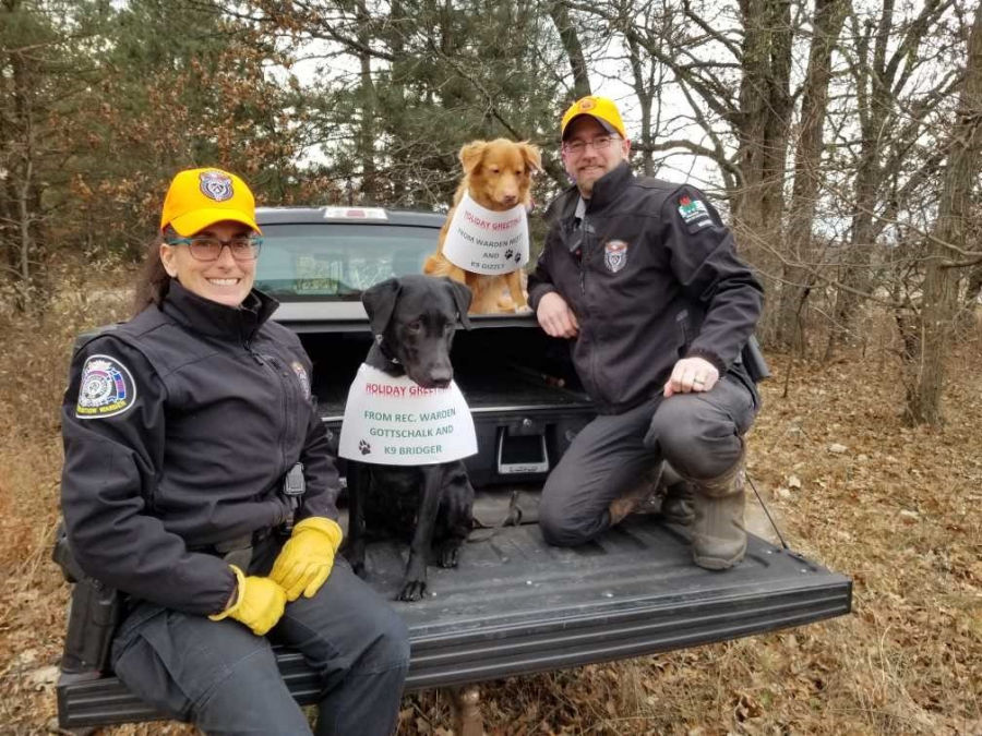 Down! WDNR Wardens Heather Gottschalk and Ben Mott, K9s Bridger and Grizzly. - Photo by J. Haas