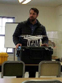 Professor Chris Johnson of the University of Wisconsin-Madison discusses the drone's capabilities at the November law enforcement training.