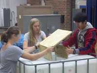 Fall Creek students build boxes for the deer dumpsters.