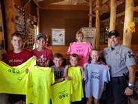 Warden Russ Fell helped kids learn about animal behavior -- and how to make cool shirts -- at the Barron County Fair.