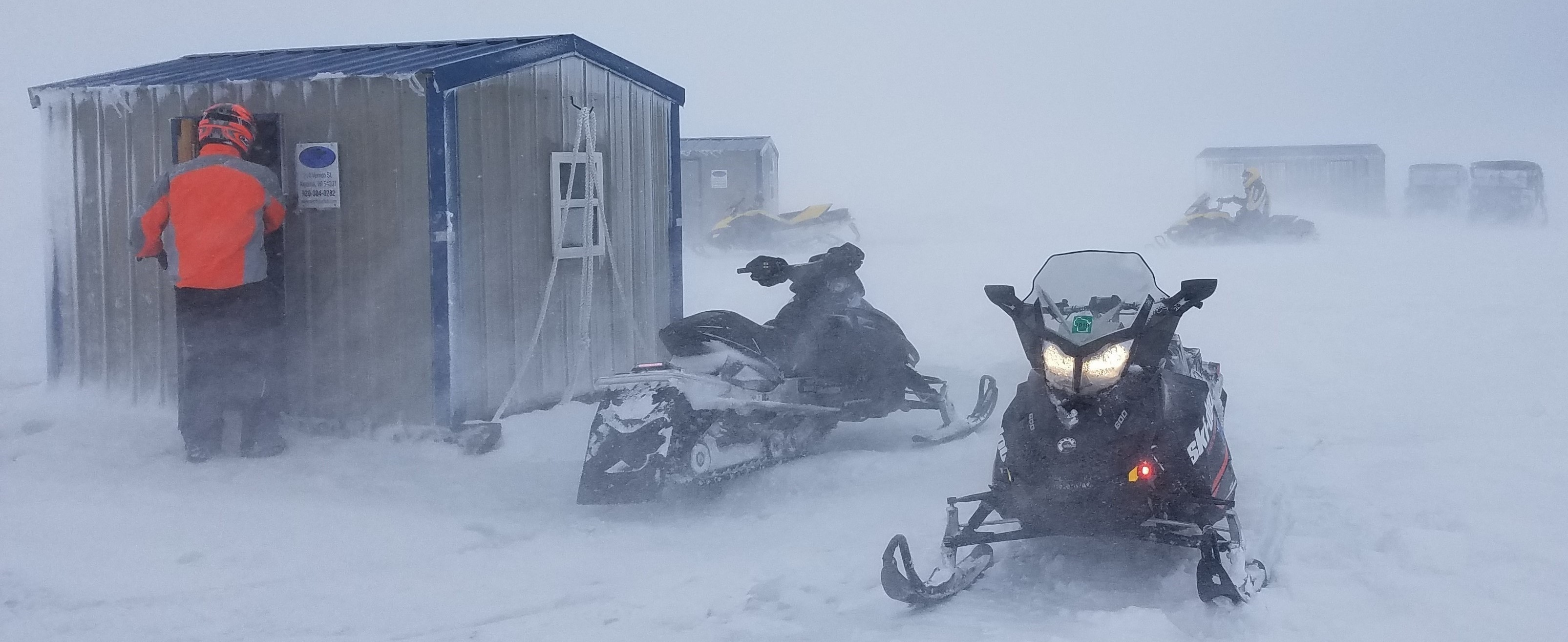WDNR Wardens check on occupants trapped in ice shanties during Sunday's white-out storm on Bay of Green Bay. February 24