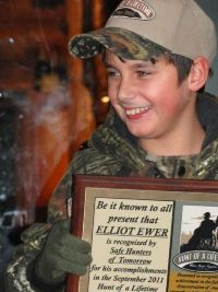Elliot Ewer of Ladysmith holds his Hunt Of A Lifetime plaque.