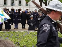 DNR Lt. Jeremy Peery stands nearby in command of two Rusk County Sheriff deputies who performed their shift on the 'watch' patrol of the Law Enforcement Memorial on May 19.