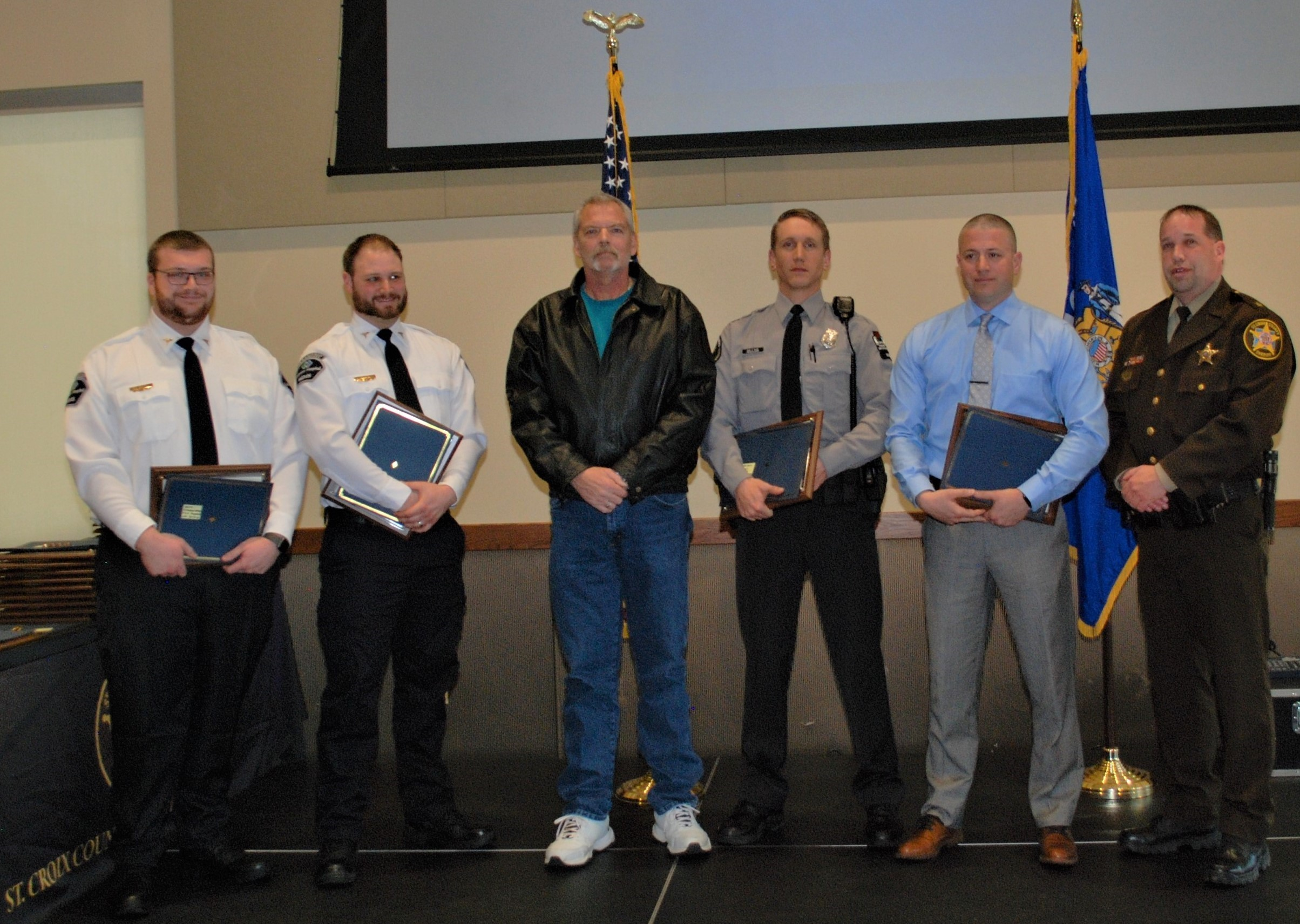From left to right, Lakeview Paramedics Kevin Zimmerman and Jeff Price, Keith Butterfield, Warden Isaac Kruse, St. Croix County Deputy Nick Krueger and St. Croix County Sheriff Scott Knudson.