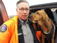 Warden Mike Clutter and Navi, who died in July.