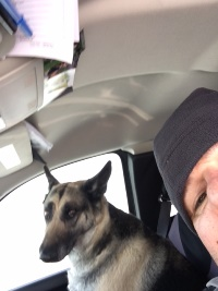 Warden Jason Higgins takes a selfie with Missy in the warm truck!