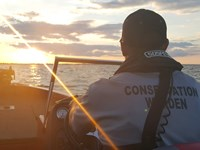 Warden Nick Miofsky on Lake Winnebago patrol during Operation Dry Water.