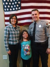 Lt. Warden Russ and Stacy Fell with young Barron County shopper.