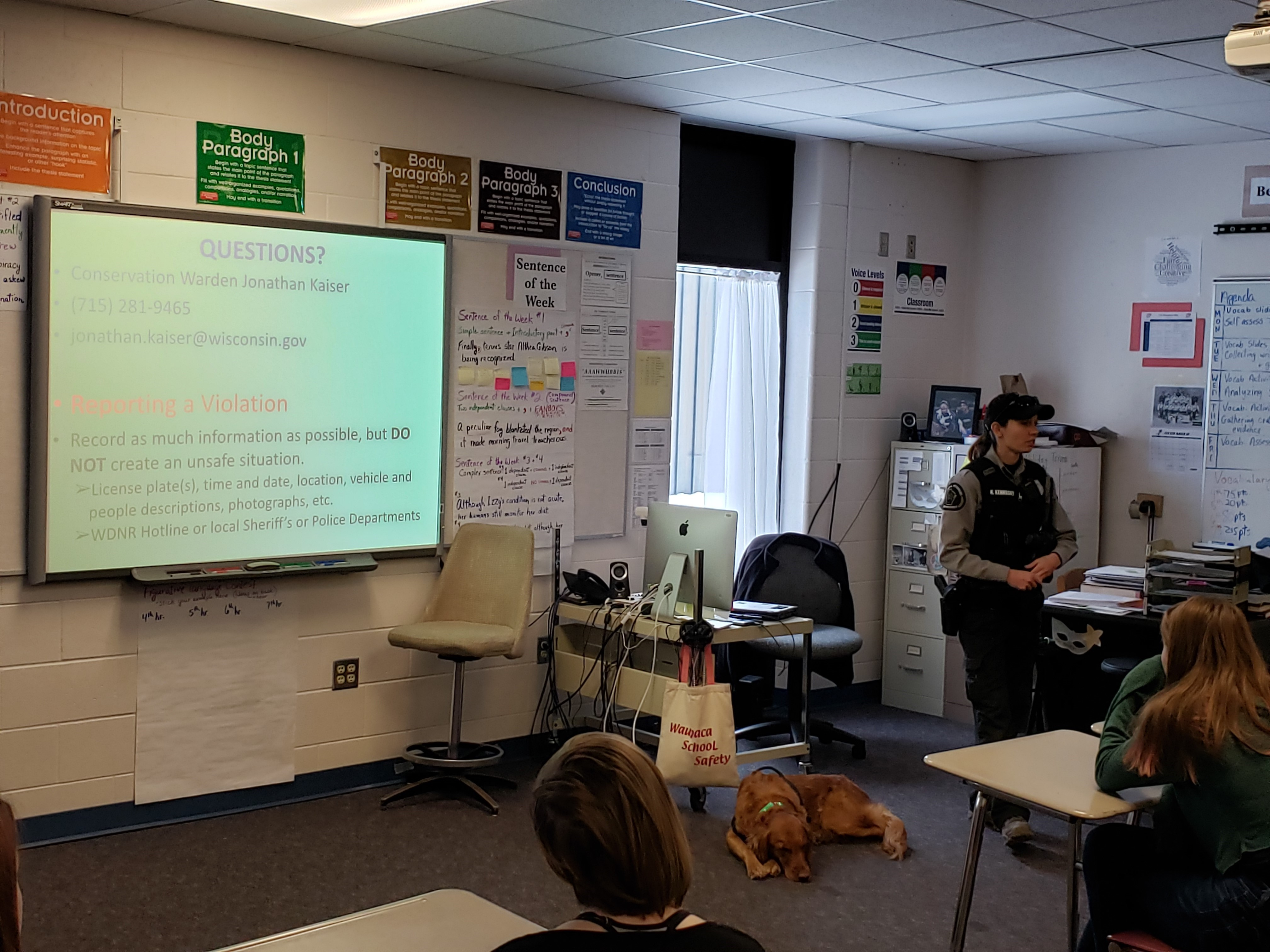 Warden Kaitlin Kernosky makes her points while K9 Teal waits for the OK to walk among the students.