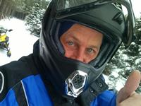 Warden Scott Thiede hits the snowmobile trails.