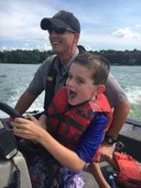 Warden Tim Werner with young boater at C.O.P.S. camp.