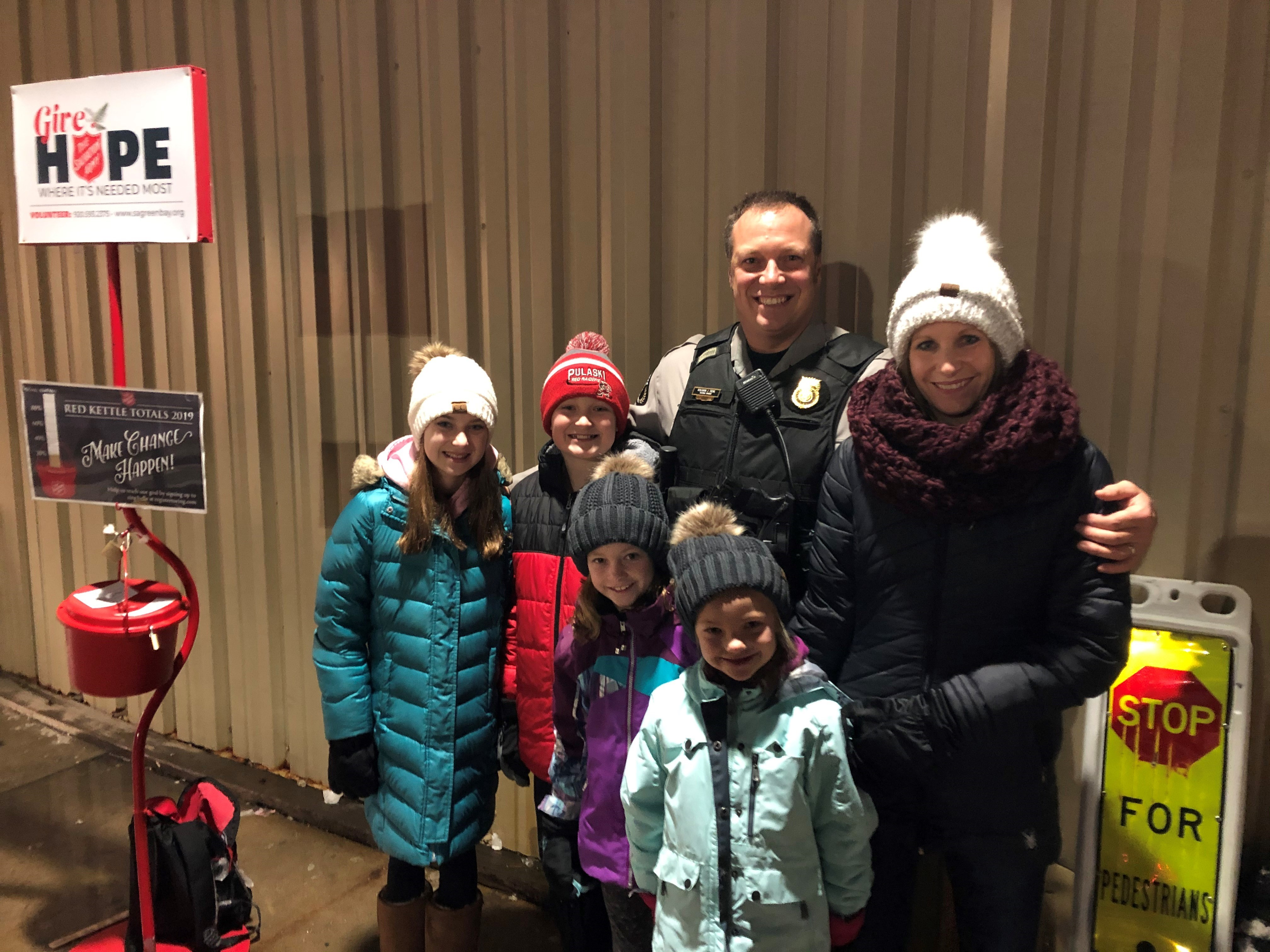 Capt. Ben Treml brought his family when he rang the red bell for the Salvation Army!!