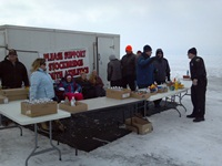 Warden Mike gets his lunch from this Stockbridge Youth Athletic Association stand. Yup, the eatery was on ice, but the brats were hot!