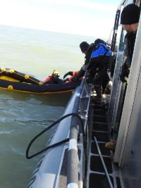 Wardens train during simlulated disaster exercise in cold Lake Michigan.